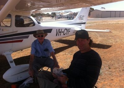 Resting under the wing at Broken Hill Airport